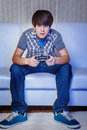 Teenage gamer in with a joystick Royalty Free Stock Photos