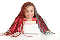 Teenage girl with african plaits and books Royalty Free Stock Photography