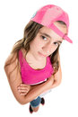 Teenage girl with an attitude wearing a baseball cap Royalty Free Stock Photo