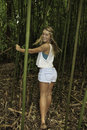 Teenage girl in a bamboo forest Royalty Free Stock Photo