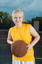 Teenage girl with basketball Royalty Free Stock Photos