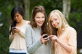 Teenage girl being bullied by text message on mobile phone upset Stock Image