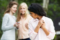 Teenage girl being bullied by text message on mobile phone upset Royalty Free Stock Image