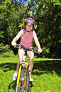 Teenage girl on a bicycle Royalty Free Stock Image