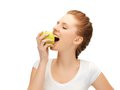 Teenage girl biting a green apple picture of beautiful Royalty Free Stock Image