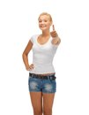 Teenage girl in blank white t shirt with thumbs up happy Royalty Free Stock Photo