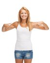 Teenage girl in blank white t shirt with thumbs up happy Stock Image