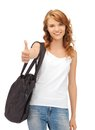 Teenage girl in blank white t shirt with thumbs up happy Stock Photo