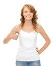 Teenage girl in blank white t shirt with thumbs up happy Royalty Free Stock Images