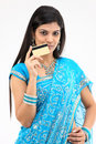 Teenage girl in blue sari holding credit card Stock Image