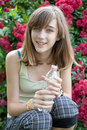 Teenage girl with bottle of water Royalty Free Stock Photo