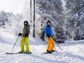 Teenage girl and boy skiing winter sports Stock Photography