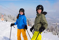 Teenage girl and boy skiing winter sports Royalty Free Stock Photo