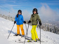 Teenage girl and boy skiing winter sports Stock Images