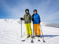 Teenage girl and boy skiing winter sports Royalty Free Stock Images