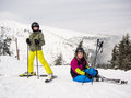Teenage girl and boy skiing winter sports Stock Image