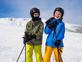 Teenage girl and boy skiing winter sports Royalty Free Stock Image
