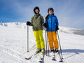Teenage girl and boy skiing winter sports Royalty Free Stock Photos