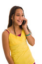 Teenage girl on cellphone looking away young latin american female telephone isolated white background Royalty Free Stock Images
