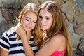 Teenage girl comforting crying friend with warm hug Royalty Free Stock Images