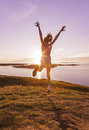 Teenage girl dancing in the sunset young enjoying life a beautiful Stock Image