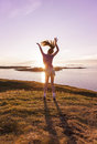 Teenage girl dancing in the sunset young enjoying life a beautiful Stock Images