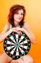 Teenage Girl and Dartboard Stock Images