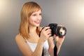 Teenage girl digital camera gray background Stock Photos