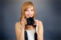 Teenage girl digital camera gray background Royalty Free Stock Photo