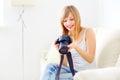 Teenage girl digital camera light background Royalty Free Stock Photos