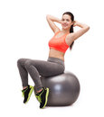 Teenage girl doing exercise on fitness ball healcare and dieting concept smiling Royalty Free Stock Photography