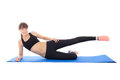 Teenage girl doing fitness exercises on a mat isolated on white background Royalty Free Stock Image