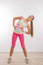 Teenage girl doing stretching exercises Royalty Free Stock Photo