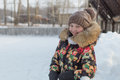A teenage girl in a down jacket in winter, ice skating, Royalty Free Stock Photo