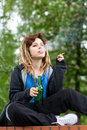 Teenage girl drinking beer and smoking cigarette Royalty Free Stock Photo