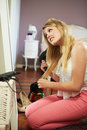 Teenage girl drying hair in bedroom looking mirror Royalty Free Stock Photos