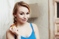 Teenage girl eating apple healthy fruit diet blond woman with braid and nutrition indoor Stock Photography