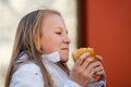 Teenage girl eating a burger young outdoor Stock Photo