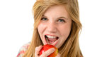Teenage girl eating healthy apple isolated on white background Royalty Free Stock Images