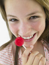 Teenage Girl Eating Lollipop Stock Photography