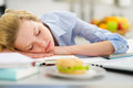 Teenage girl fall asleep while studying in kitchen modern Stock Images