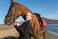 Teenage girl with a favorite horse portrait of at the sea autumn Stock Image