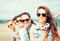 Teenage girl with friends outside summer holidays and concept Royalty Free Stock Photo