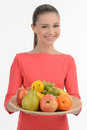 Teenage girl with fruits happy teenage girl holding a plate wit while standing on white Stock Photography
