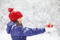 Teenage girl with a gift in their hands pretty her adolescent winter outdoors Stock Images