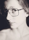 Teenage girl glasses black white Royalty Free Stock Photography