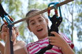 Teenage girl having fun on a rope park adventure course in eucalyptus forest Stock Images