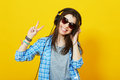Teenage girl with headphones smiling showing peace gesture Royalty Free Stock Photo