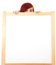 Teenage girl hiding behind blank board Royalty Free Stock Photo