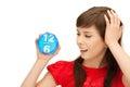 Teenage girl holding alarm clock